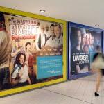 Wandplakate zur Imagekampagne an der Wand einer Unterführung